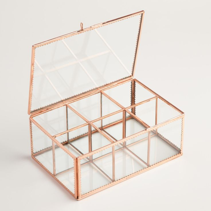 With a sophisticated copper frame and clear glass panes, our exclusive tea storage container organizes bagged or loose-leaf teas in six spacious compartments. Available at a remarkable price, it's a fantastic gift for any tea lover.
