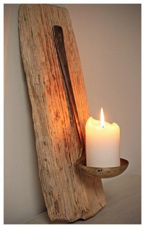 Driftwood with a ladle and candle - rustic, but cool.