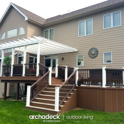Our client here in Urbandale, NW of Des Moines, wanted to expand their deck for a hot tub.  The upper-level shown here was the existing space…a composite deck, with (originally) wood railing.  We designed a space that located the hot tub on a lower-level deck, separating its functionality from the upper grilling and seating areas.  We did new TimberTech Radiance Rail all around the structures (two-toned, white and walnut), added the white vinyl pergola over the upper deck and built a corner…