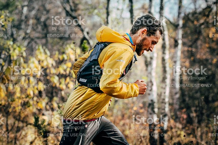 Beloretsk, Russia -  September 26, 2015: young male athlete running in autumn Park during marathon mountain 'Big Iremel'