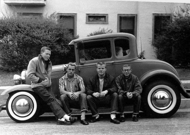 greasers...this could have been my late older brother and his hot rod!!! Check out the hair...!!