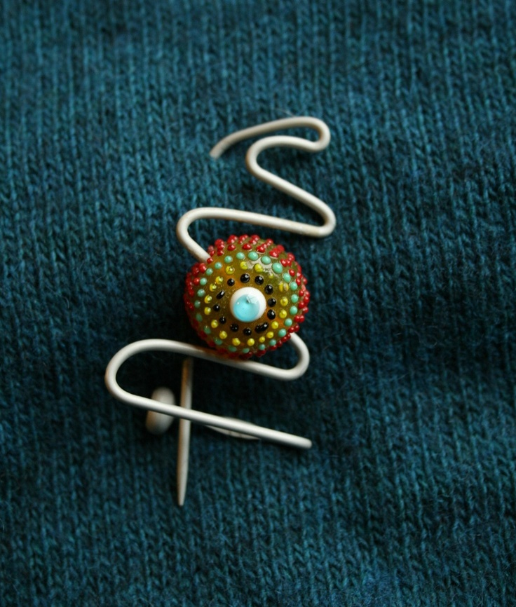 Repurposed upcycled Vintage knitting needle wirework shawl pin with glass bead. $12.50, via Etsy.