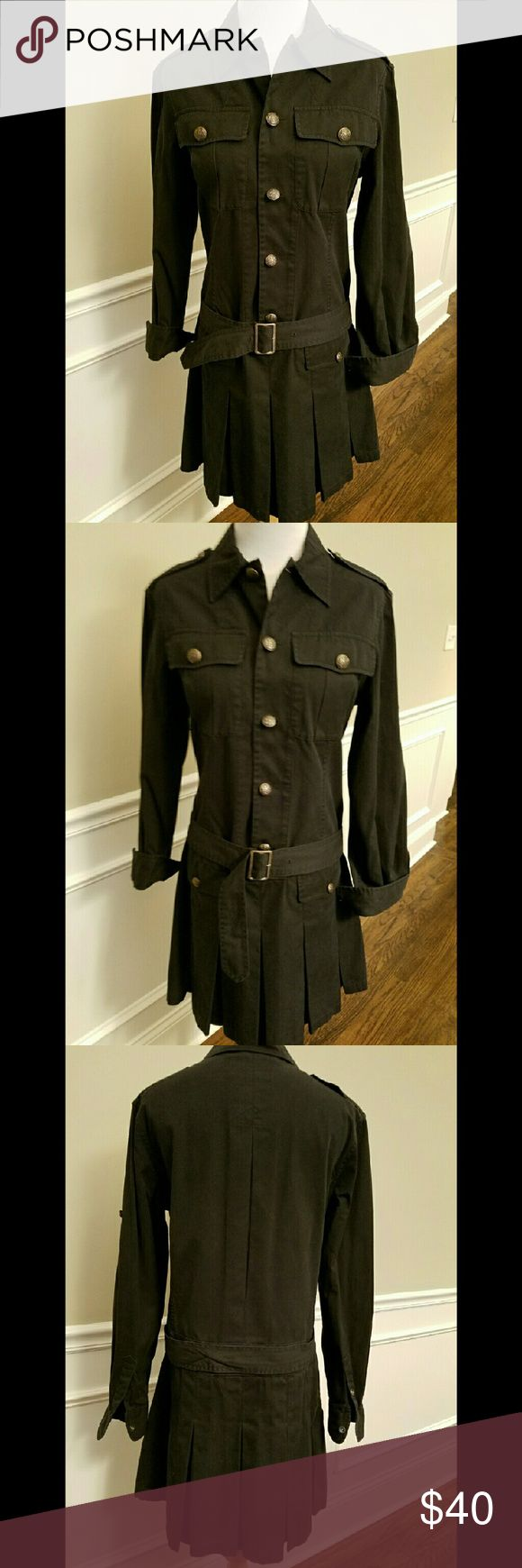 """Black Ralph Lauren Military Style Cotton Dress Black cotton button front dress from Ralph Lauren Rugby in size 8. Brass buttons on front and sleeves, optional wide belt with brass buckle (shown with and without in photos), two breast pockets and two pockets on skirt. Drop waist and pleated skirt. Measures 35"""" long and 18"""" across the bust. Absolutely stunning and in perfect condition. Ralph Lauren Dresses Midi"""