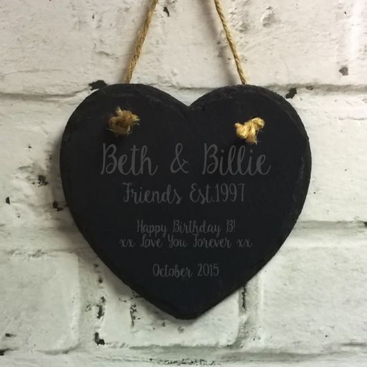 Slate Heart Decoration.  Beautiful slate heart that makes a stunning home decoration and can be personalised with any name, message and date.  Our delightful slate hearts are an amazing gift to give as they are modern in looks with the hanging string adding a rustic feel. They will look stunning when hung around the home or at a contemporary wedding day.