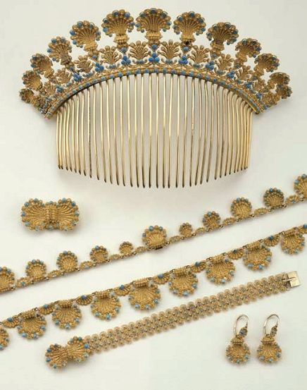 "Antique parure in gold and turquoise glass paste consisting of a necklace with shell motifs arranged in gradated array, decorated with turquoise glass paste; a tiara; a pair of earrings; a bracelet; and a buckle, ""en suite."" Flaws and shortcomings: elements of the tiara welded, French stamp 1819-1838' Christie's Rome June 2004"