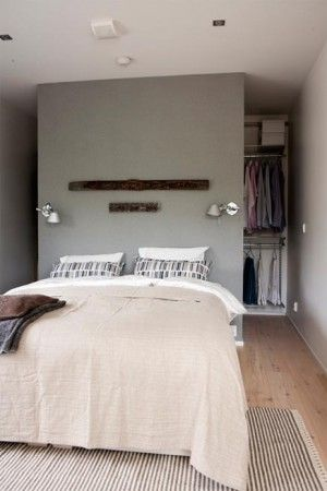 Best treatment for a long narrow room, add wall, storage behind - where this photo has exposed hanging - use drawers/cabinetry - have exposed behind wall on both sides