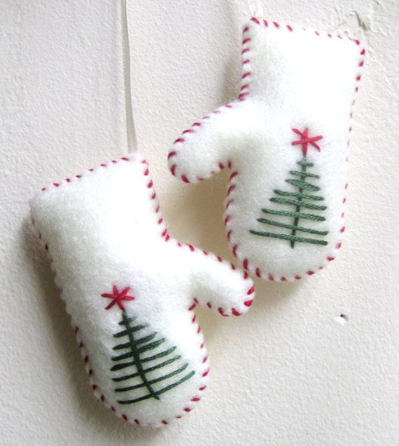 I like the simple embroidered Christmas tree with star on these. Mittens Christmas ornament in white felt by MakeCreateNYC on Etsy, $8.00