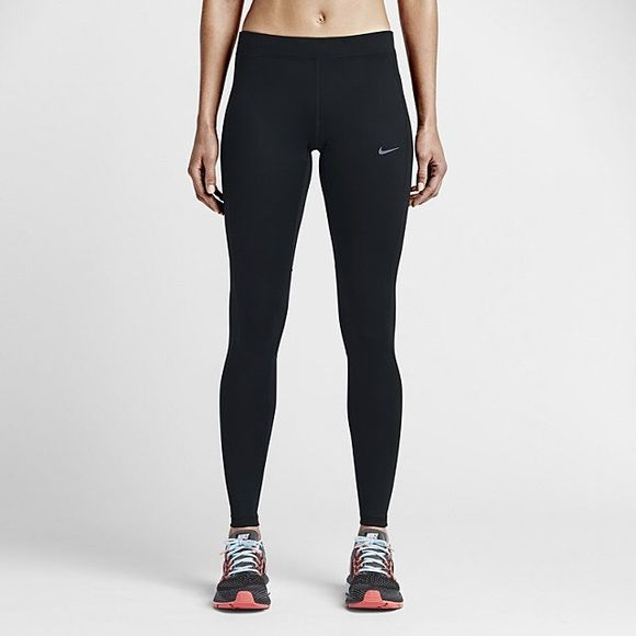 Nike dri fit running tights Black nike running tights. Has a zipper pocket on the back above the butt. Hidden pockets in waist band. Zipper closure at the ankle. Barely worn. Nike Pants