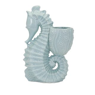 Seahorse Ceramic Planter This Ceramic Seahorse Planter will bring coastal charm to your home decor. Add a colorful plant to this stunning seaside sculptural ceramic planter, showcasing a seahorse desi
