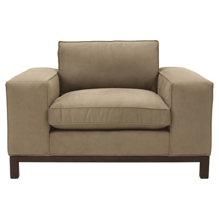 Low-profile club chair with block arms and piped faux suede upholstery.    Product: ChairConstruction Material: H...