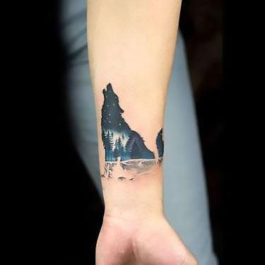 Amazing Small Wolf on Wrist Tattoo Idea