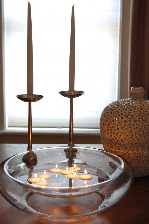 Make floating candles from votive candles. Remove outside metal container and drip hot wax over the metal square on the bottom to seal the candle from water.