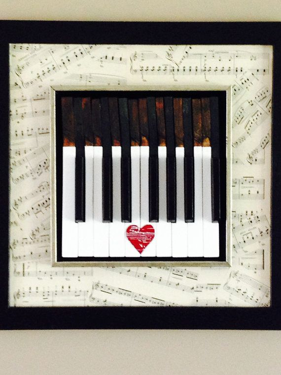 Want a perfect gift for a pianist? Looking for unique one of a kind art for your home? The piano keys framed art dances to the sound of a piano forte for sure with the added bonus it looks great too! This art piece features piano keys set into a black and silver wood inner frame set onto a larger black wood frame with a collage of vintage sheet music that has natural yellowed look from aging. The keys are from a 1930s antique piano that was in poor condition. In the center of the keys is an…