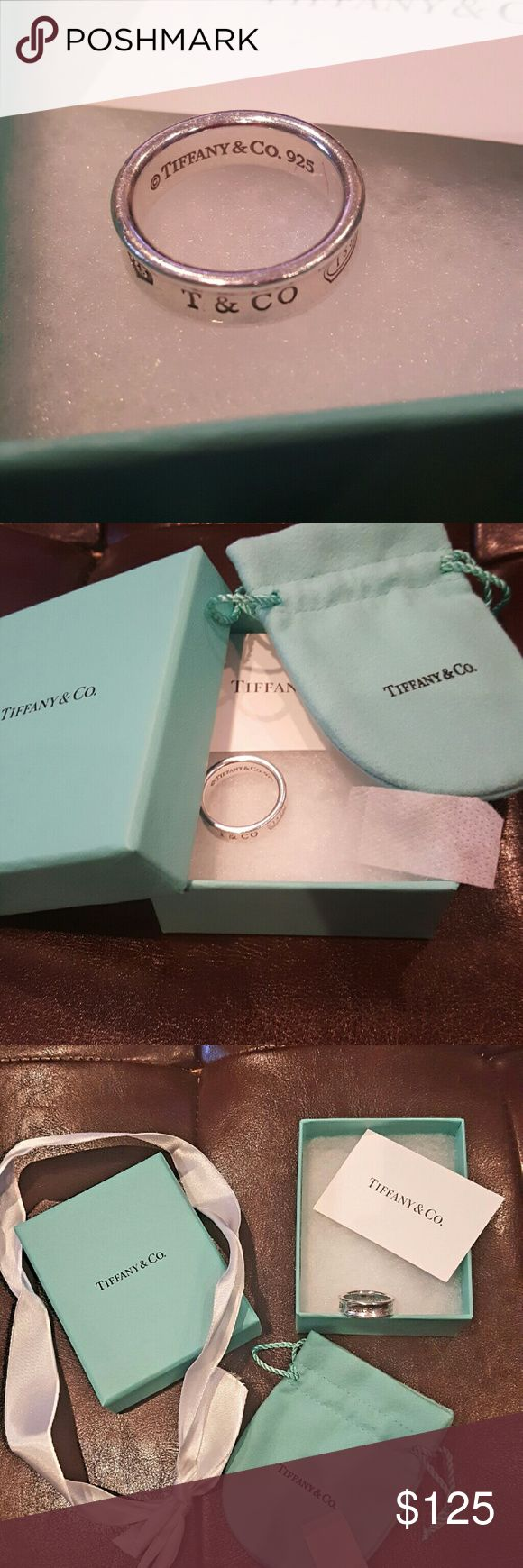 Tiffany & Company Ring ?? Beautiful silver ring in EUC. Has one chip,  see last photo. Size 9. Box, bag, card, ribbon included ?? Tiffany & Co. Jewelry Rings