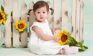 Photography sessions with studio backdrops and props add personal touches to a family portrait photo shoot