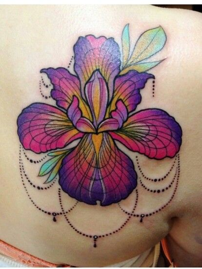 The Iris is a symbol of love. It can grow in any environment. I have to get this tattoo.