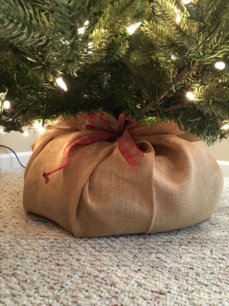 wrap a pool noodle along your christmas tree stand wrap it in burlap and secure