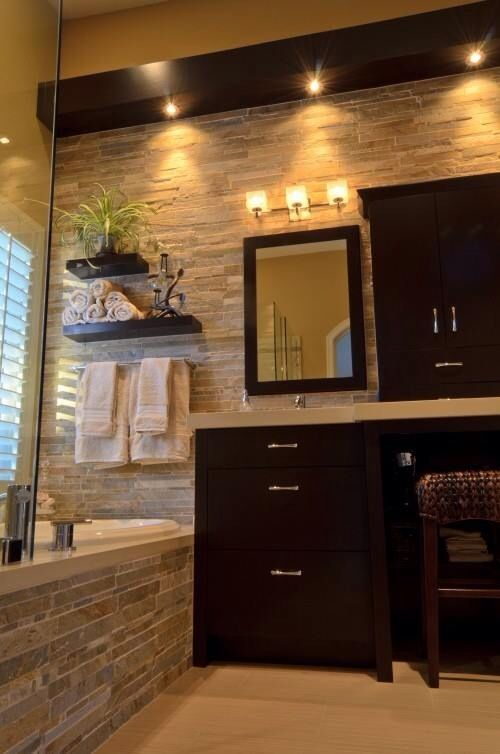 Master bathroom... Might be a little too dark though, but like the wall/stone detail