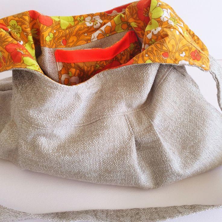 New listing!  I love this one  Individual, one off, handmade handbag. Beige with vintage orange flower sheet.