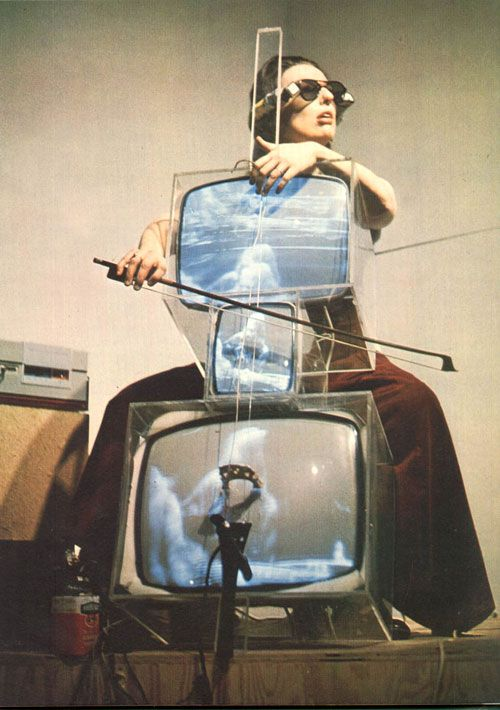 NAM JUNE PAIK. Strange, weird, and beautiful.  Unique photography composition.  Chello Television.