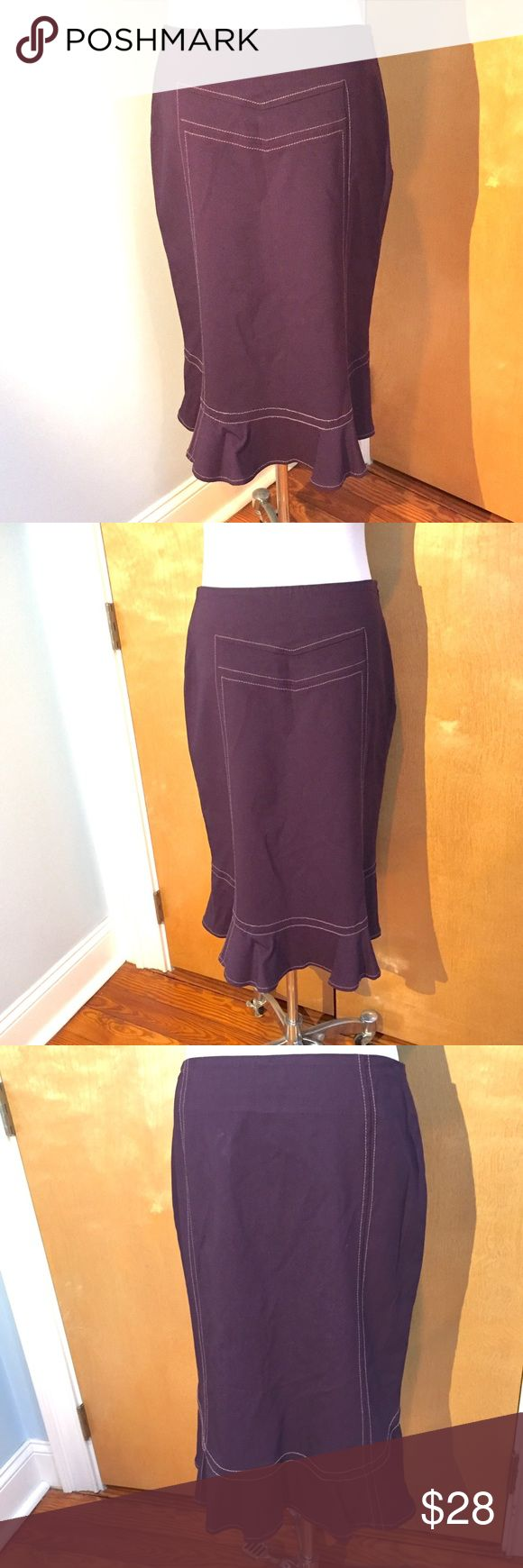 "🆕Anthropologie Elevenses Trumpet Flounced Skirt Anthro flounces trumpet skirt in a lovely purple/eggplant color. Lovely panel stitching (thread is a light plum/pink? See pics). Slip underneath is trimmed with lace. Excellent used condition. Back zip. 76% rayon 21% nylon 3 % spandex lining 100% acetate. Approx measures lying flat waist 15"", length 25."" Dry clean. Smoke free/pet friendly home. DC Anthropologie Skirts"
