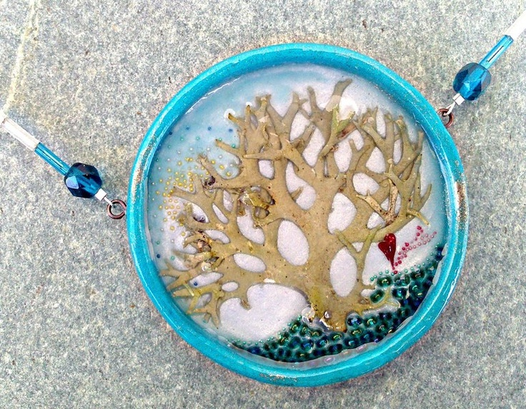 Hand made polymer clay necklace. Main body filled with liquid glass,glass beads and a piece of moss. The inspiration behind this piece, a walk to t...
