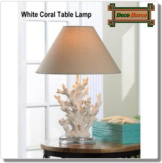White Coral Table Lamp - This stunning table lamp features artistically rendered ivory sprigs of coral topped with a handsome neutral-color shade. Turn on the lamp and your room will light up with a warm and inviting glow. A splash of seaworthy style to light up your life!