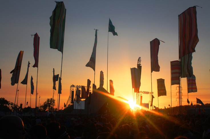 Glastonbury festival crowd sunset
