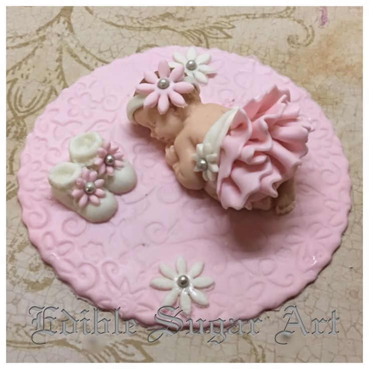 """Baby shower fondant cake topper 2 1/2"""" fondant baby in fondant skirt on 4"""" fondant base. With flowers and mini booties FAQ Please read prior to purchase. Thanks! :~) ~PLEASE allow 5-10 business days f"""