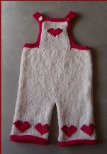Knitting pattern for baby overalls with heart motifs.