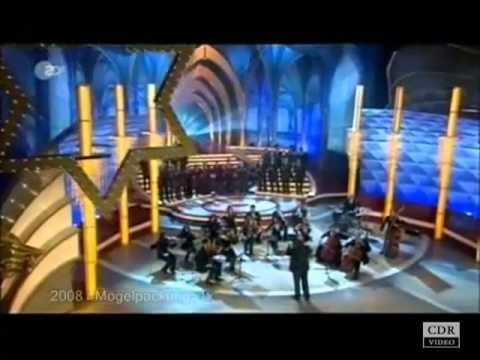 "The Choir of the Diocese of Rome directed by mons. Marco Frisina German guests of the show Wilkommen bei Carmen Nebel, performing the song ""Jesus Christ you ..."