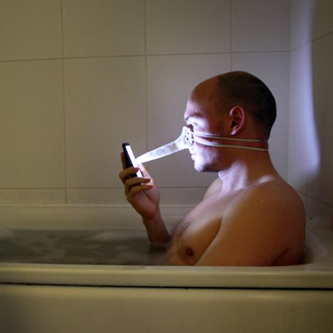 London designer Dominic Wilcox created this stylus that straps over his nose for using his touch-screen phone in the bath.: Fingers Nos Stylus Looks, Bathtubs, London Design, Fingers Nose, Gloves, Nose Stylus, Domination Wilcox, Bizarre Inventions, Phones