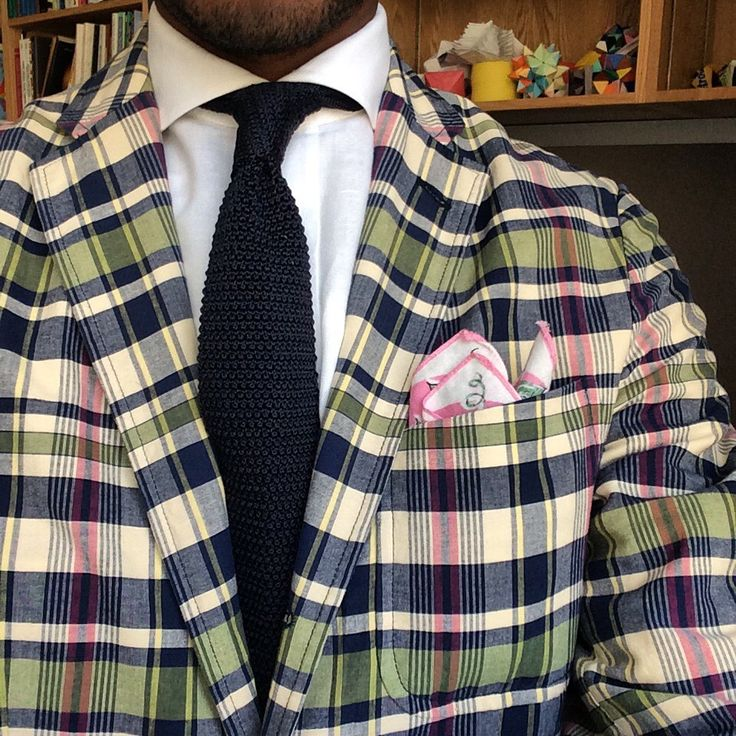 Plaid jacket, white shirt, navy knit tie