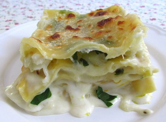 Cod lasagna | Food From Portugal. Cod lasagna is a tasty recipe of cod sautéed in olive oil, onion, garlics, oregano and pepper, wrapped in pasta layers with béchamel and whipping cream sauce, sprinkled with grated cheese. http://www.foodfromportugal.com/cod-lasagna/