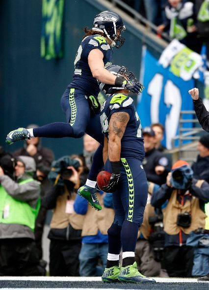 TE Luke Willson jumps for joy after T Garry Gilliam's touchdown reception from P Jon Ryan on a fake field goal. The score cut the Green Bay lead to 16-7. The comeback was on!
