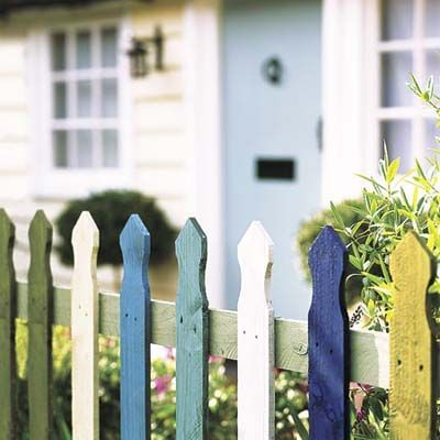 Playful multi-colored picket fence treatment. | Photo: Alun Callender/IPC Images | More at thisoldhouse.com