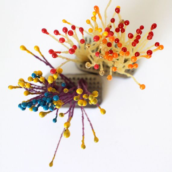You know those little fake pollen bits you see used in paper flower  making... Anatomically they're called stamen but in paper flower world  they're called pips. And they're not so cheap for something called a pip!  You'd think they'd just cost pip cents each. Well some are reasonably  priced bu