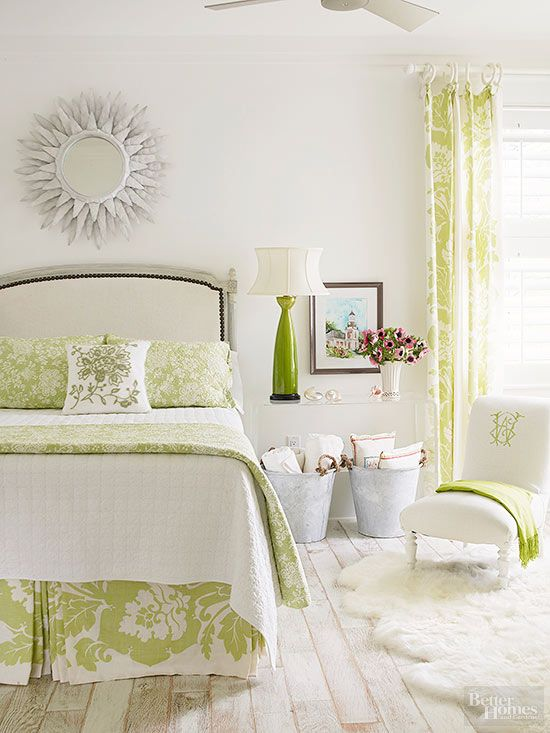 The Look: White + more white + celadon green, modernized cottage style (minimalist color, Lucite table, sheepskin rug, classic bed frame and bedding and traditional damask-like patterns)