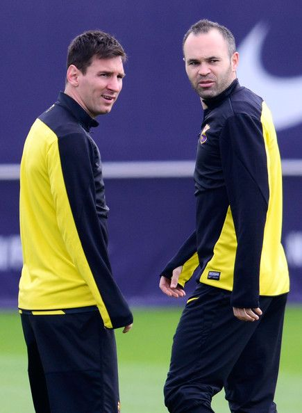 Lionel Messi and his teammate Andres Iniesta of FC Barcelona during a training session ahead the UEFA Champions League Quarter Final first leg match against Atletico de Madrid at Sant Joan Despi Sport Complex on March 31, 2014 in Barcelona, Catalonia.