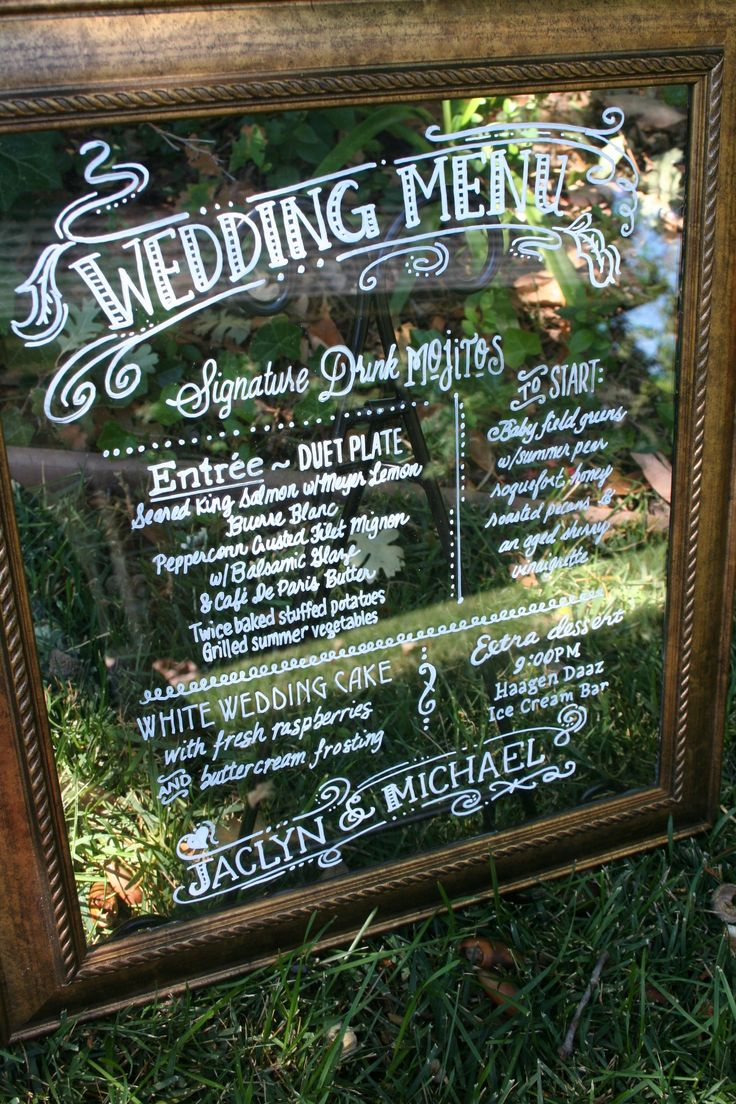 Wedding menu on glass. new bronze colored frame - put the table plan on a mirror :)