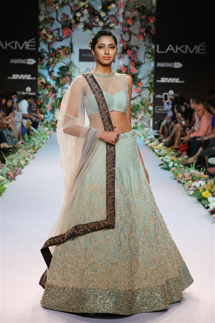a beautiful dusty aqua panelled lehengha with a subtle dori work jaal and shimmer sequins embroidery. This is teamed with a stylish pleated blouse and a contrast border dupatta.