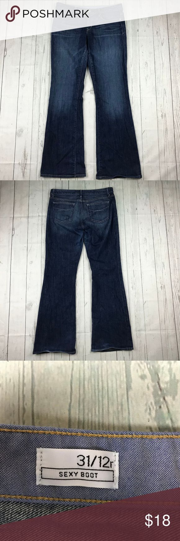 Gap 1969 medium tint sexy boot cut stretch jeans Gap 1969 jeans women's size 12 waist 31 medium tint wash sexy boot cut stretch denim. Made of 98% cotton and 2% spandex.  Waist measurement: 16.5 inches (across the top) Length measurement: 41 inches Inseam measurement: 31 inches GAP Jeans Boot Cut