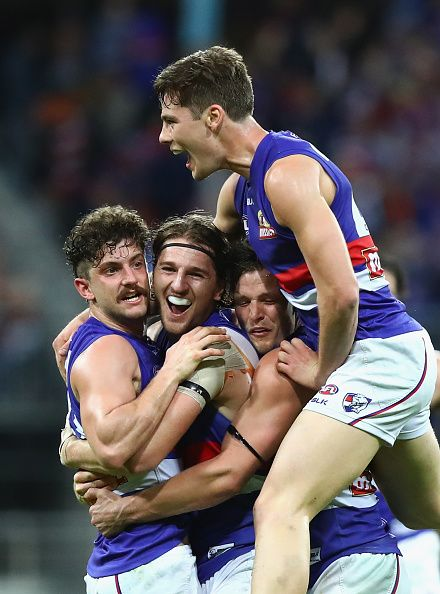 Tom Liberatore Marcus Bontempelli Dale Morris and Josh Dunkley of the Bulldogs celebrate victory after the AFL First Preliminary Final match between...