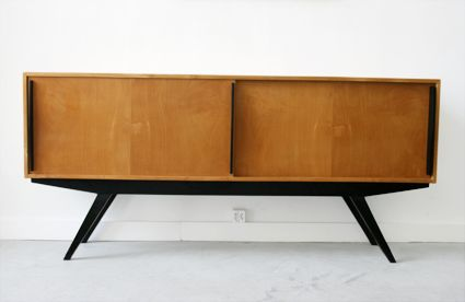 "Knoll/Wohnbedarf, 1947 - Birch sideboard with sliding doors, base in black enameled wood. Rare version with triangle grips. Size 72""L x 15""W x 32""H"
