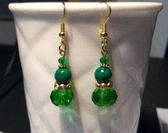 Lovely Swarovski crystal and Crysocolla green gemstone earrings in green and gold tones. $9