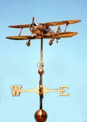 Beechcraft Staggerwing Airplane Weather Vane by West Coast Weather Vanes.  This custom made handcrafted Beechcraft airplane can be made using a variety of metals with optional gold or palladium leafing.