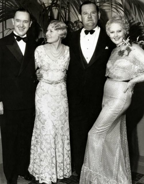 Stan Laurel and Oliver Hardy with their wives