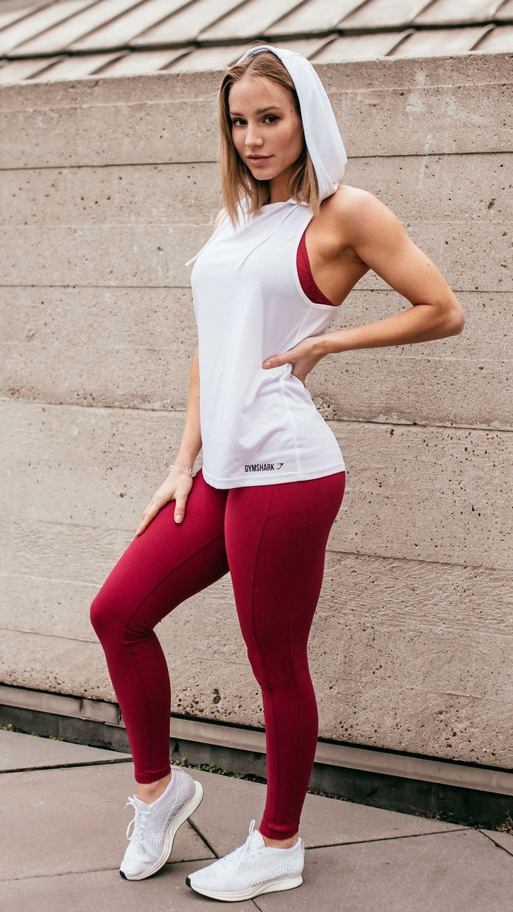 Fresh workout style. Gymshark Athlete, Robin Gallant styling the Hooded Vest in White and Leggings in Beet. #gymshark