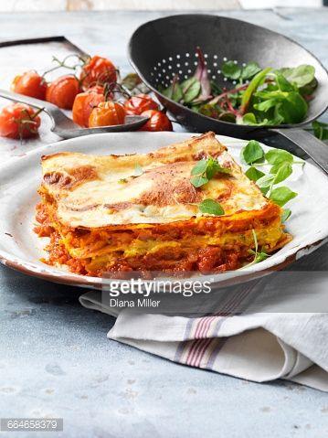 Stock Photo : Food, vegetarian meals, roasted butternut squash lasagne, cheese, tomato, salad, vintage plate, rustic metal colander