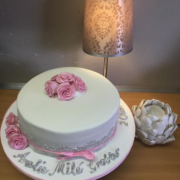 Christening cake with pink fondant roses